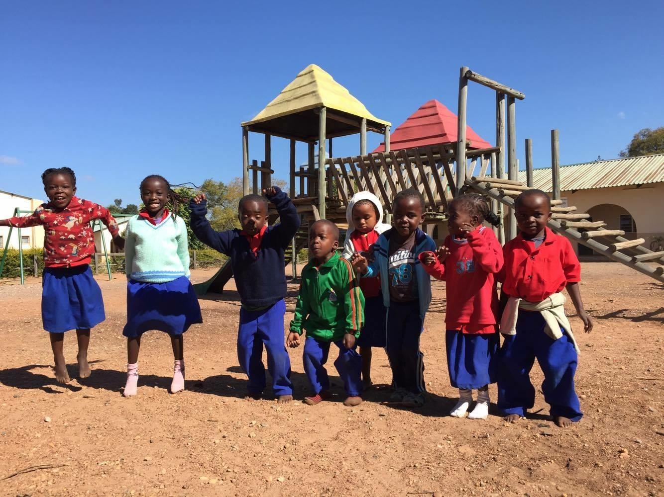 Kafakumba children standing in front of playground